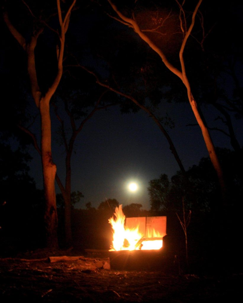 Moon rising over the fire. We decided this was an amazing dinner view.