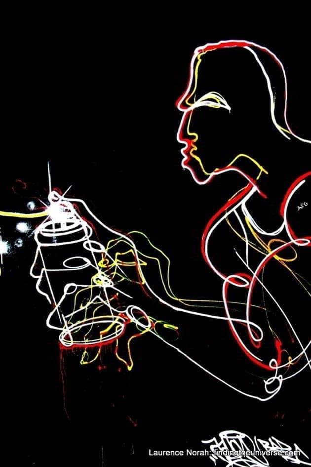 Spray can artist, East side Gallery, street art, Berlin, Germany