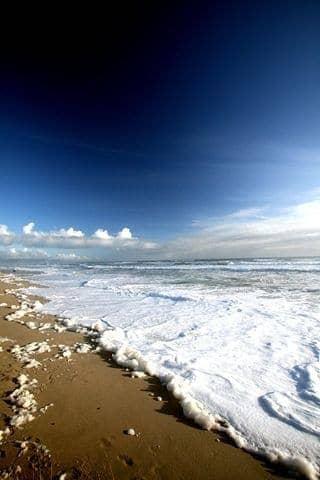 Foamy beach near Karamea