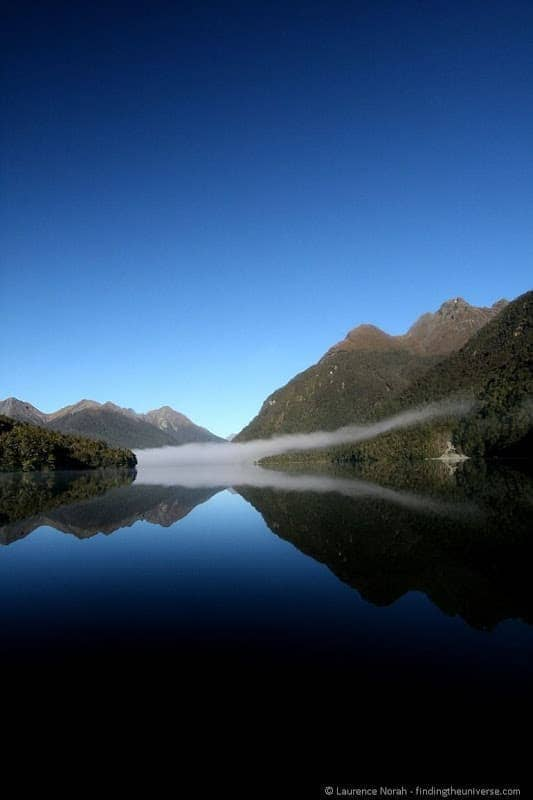 Mountain lake cloud reflections