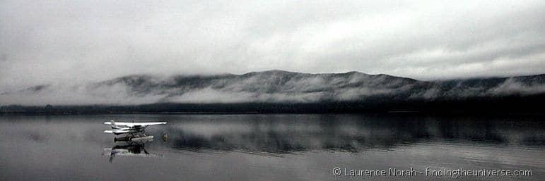 Sea plane on misty lake