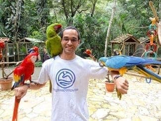 Me with birds at Macaw Mountain Bird Park In Copan Ruinas Honduras