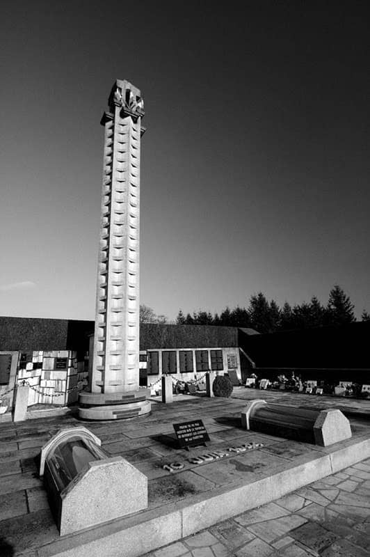 Oradour Sur Glane Graveyard and memorial wall bw