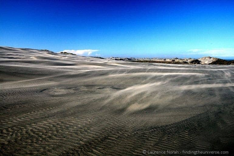 Sand blowing over dunes