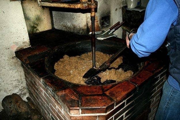 Walnut oil maker stirring