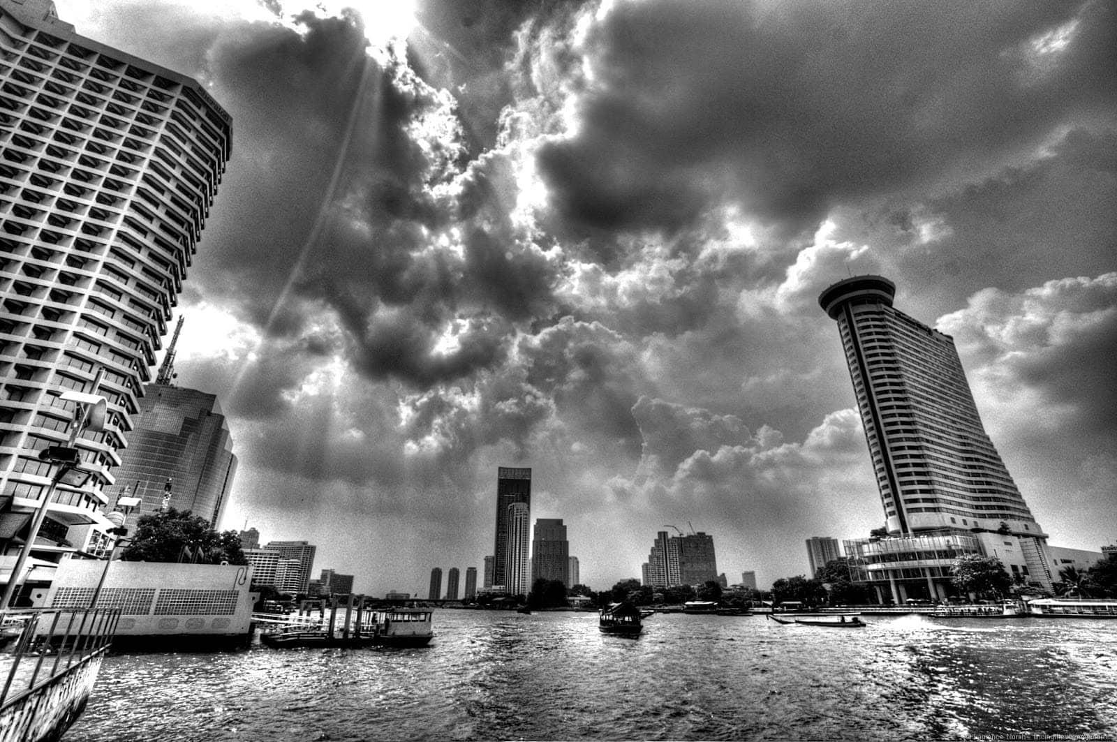 Bangkok Chao Phraya river old and new black and white