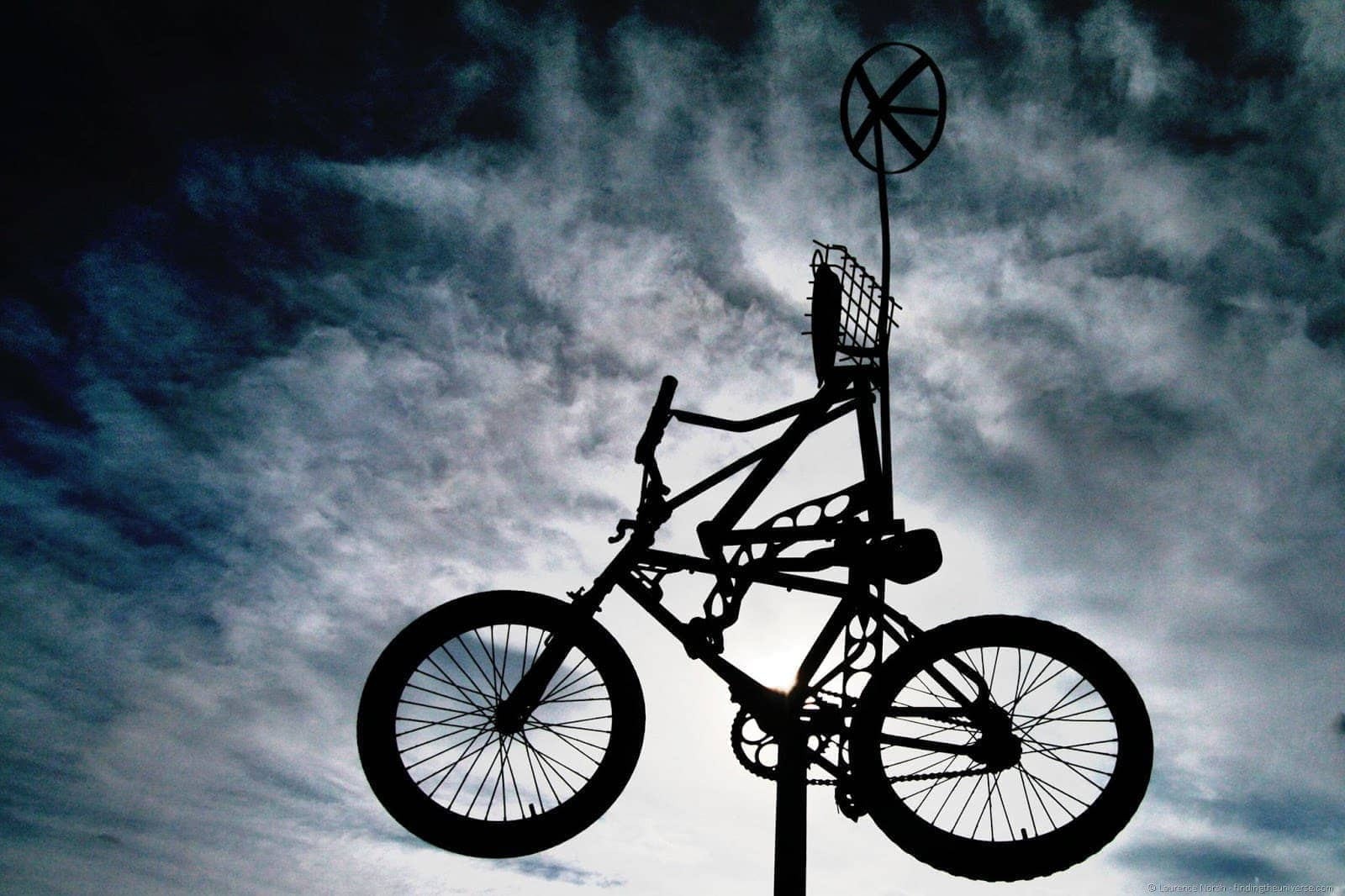 Flying bicycle against sky silhoutte