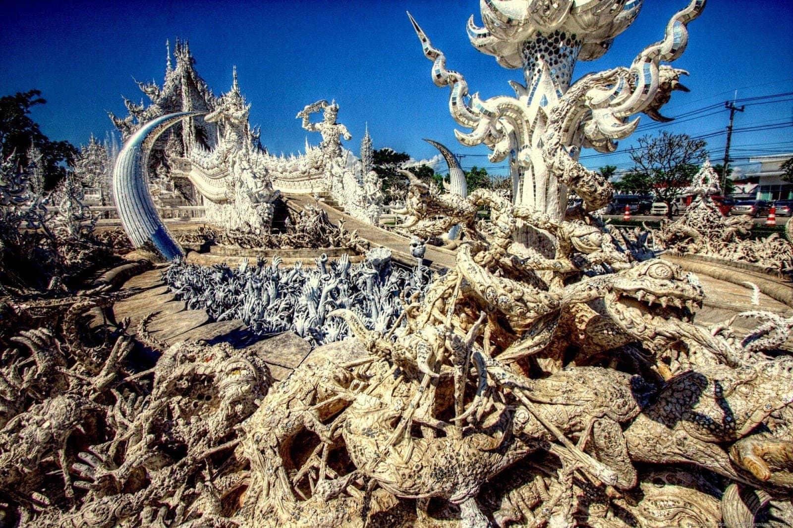 White temple hands Chiang Rai Thailand