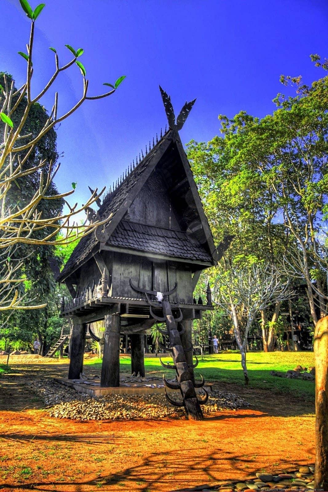 Black temple Chiang Rai small house on stilts 2