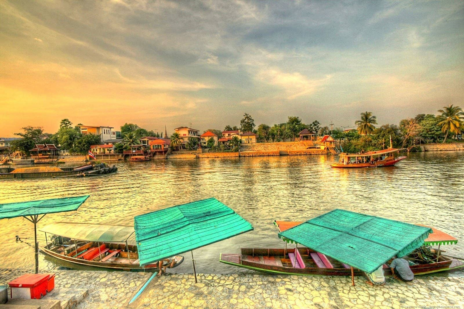 Boats on Chao Phraya River at sunset