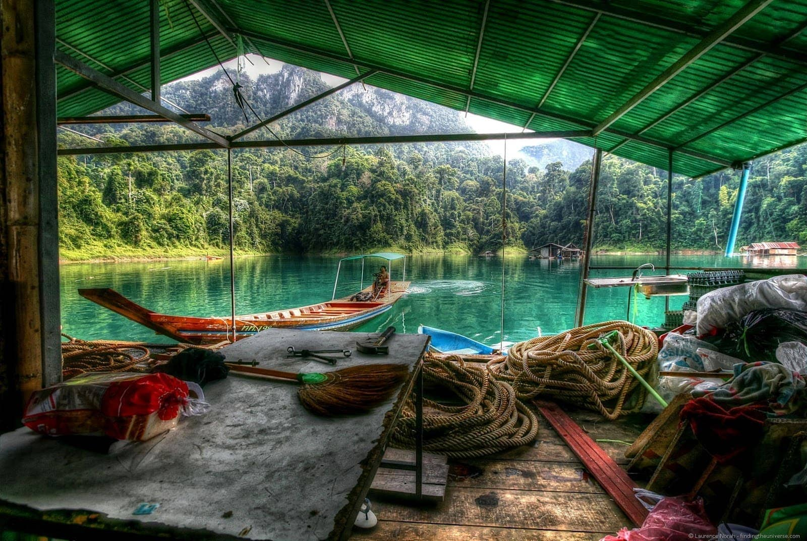 Long tail boat pushing lake house khao sok national park thailand