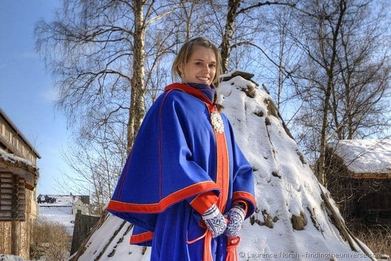 Girl in traditional Norwegian dress landscape
