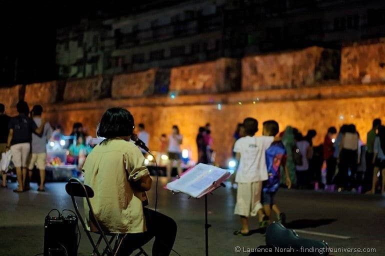 Songkhla night market guitar player city walls