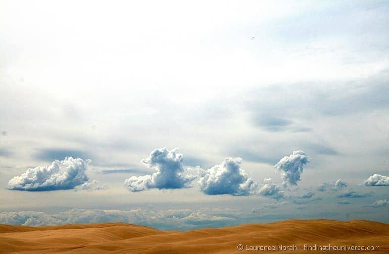 Sand dunes and clouds