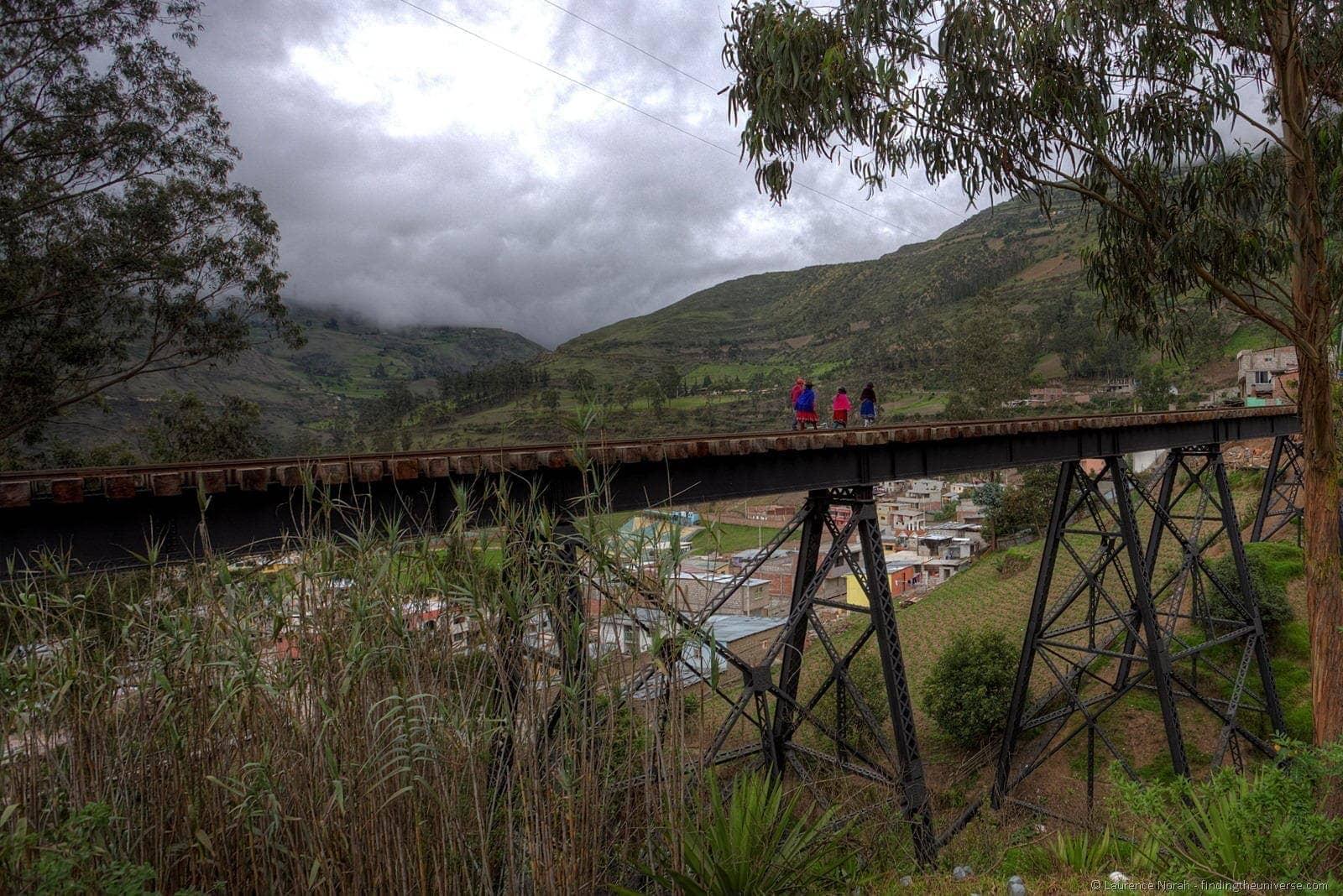 locals walking across el puente negro alausi