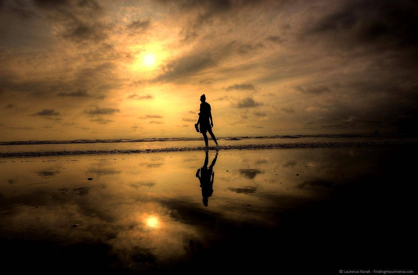 Girl at sunset reflection Canoa Ecuador 2
