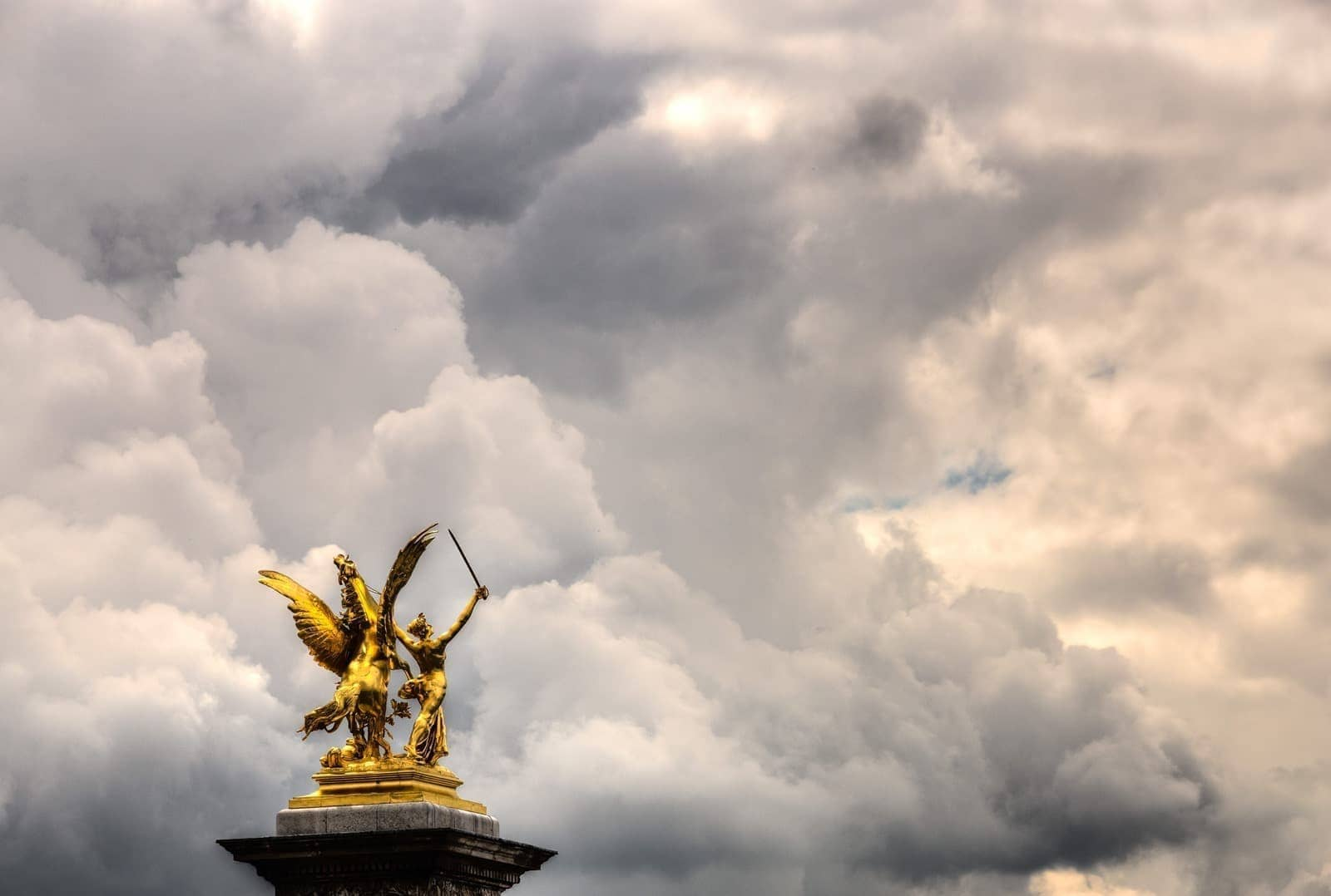 Statue and clouds river seine Paris bridge