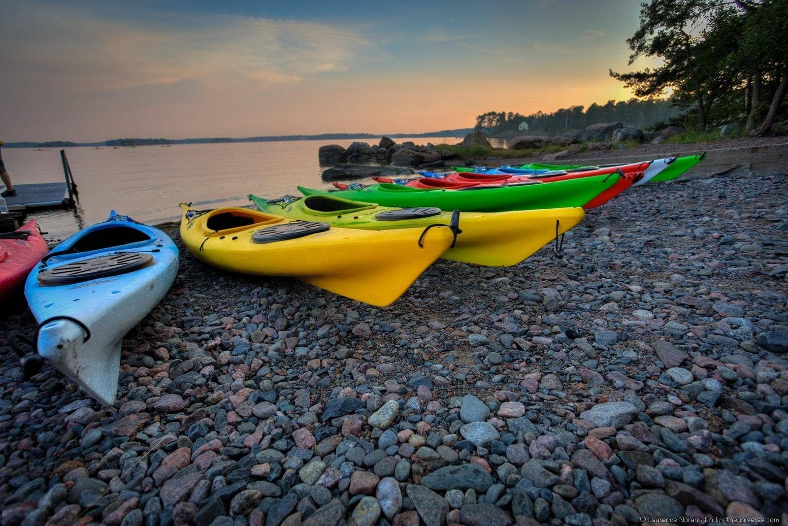 canoes by the lake Finland sunset