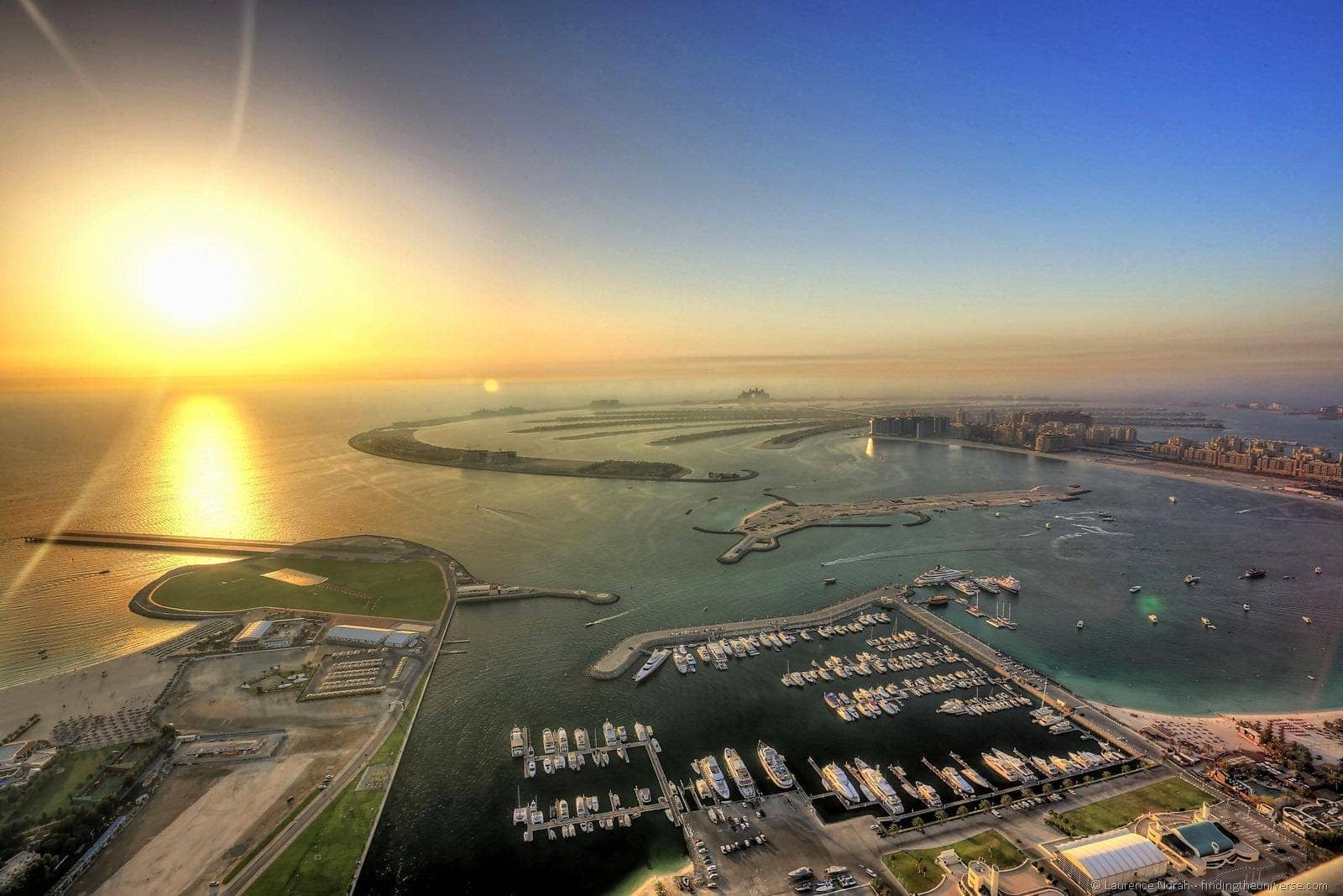 sunset across the palm marina dubai
