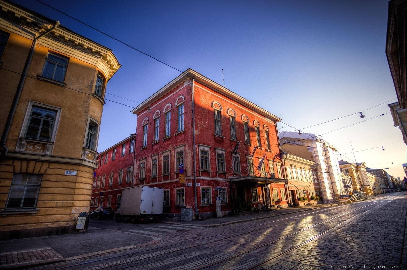 helsinki street sunset tram tracks red house
