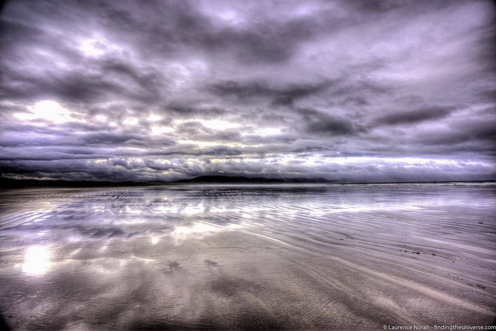 Ireland beach clouds sky reflection - scaled