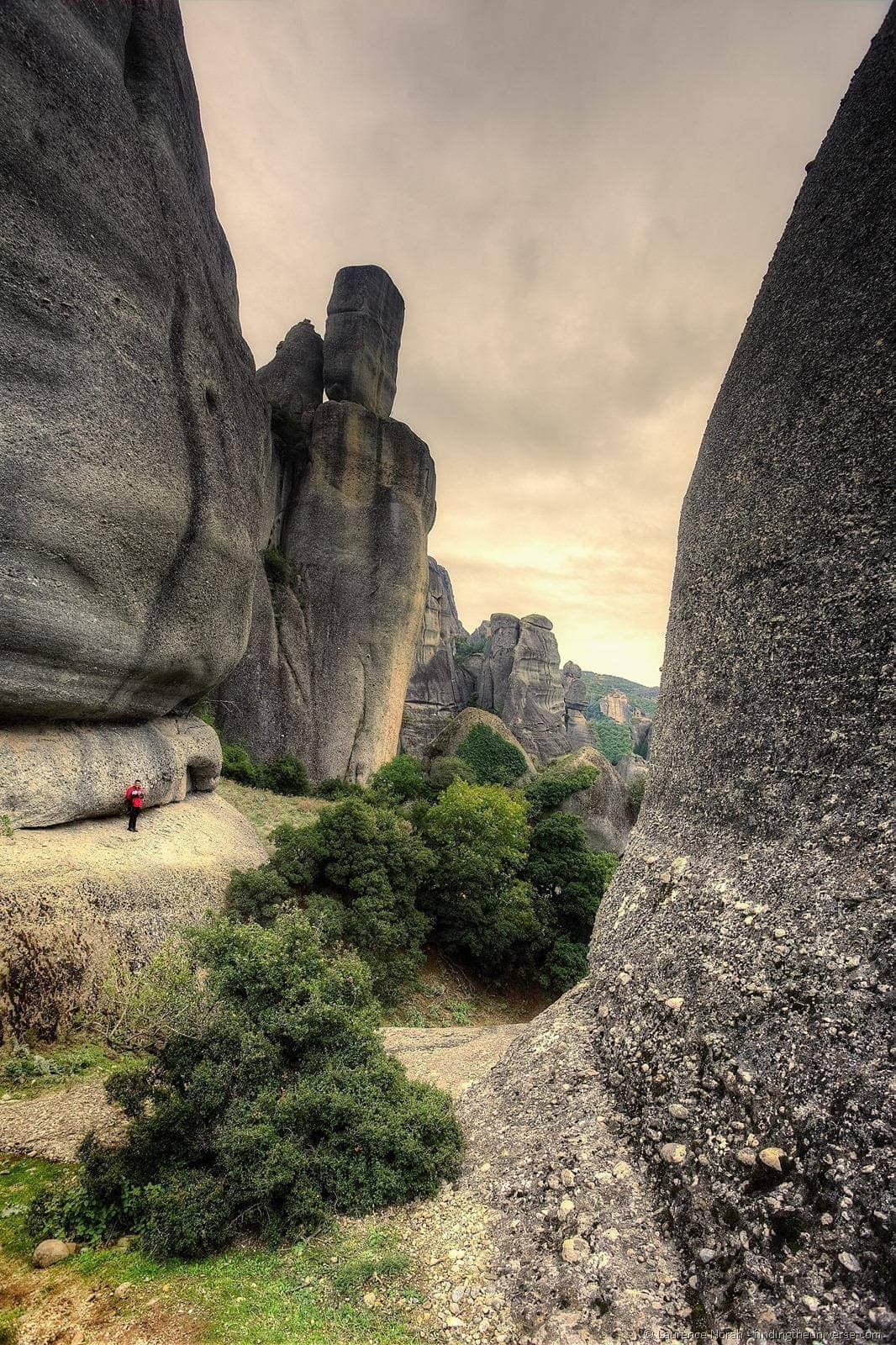 man in rock formation meteora greece