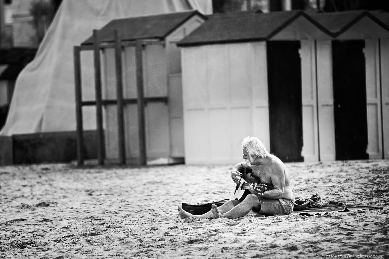 man playing guitar beach pesaro italy