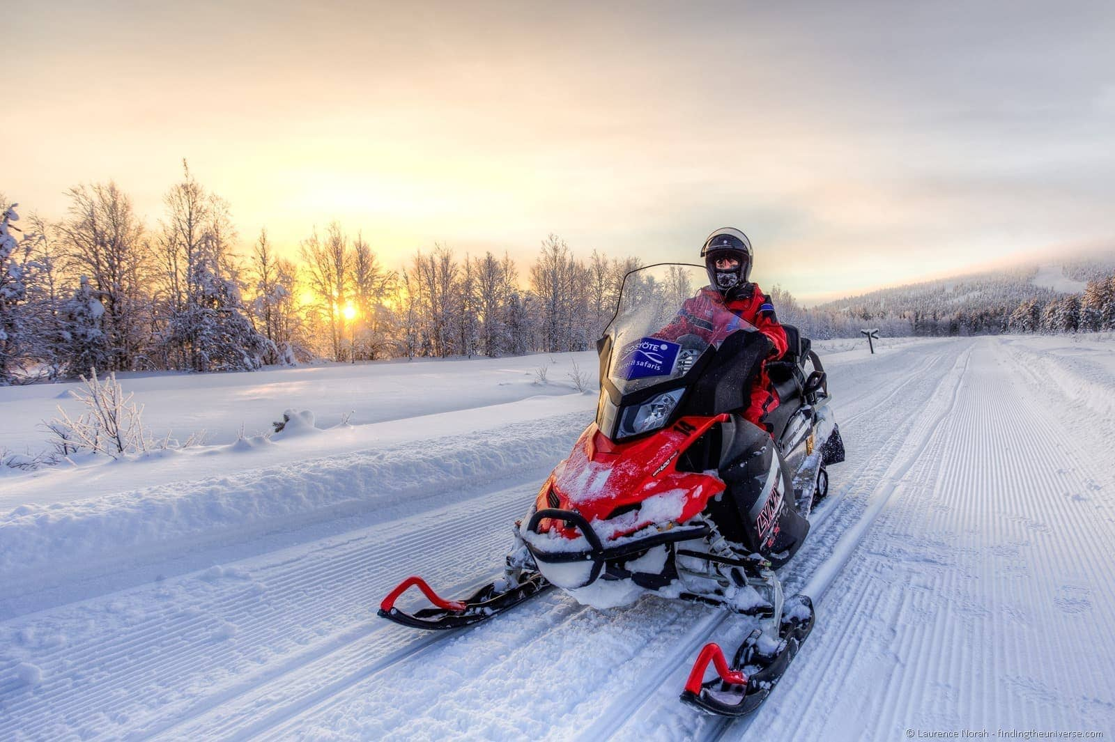 girl snowmobile Iso Syote lapland sunset finland