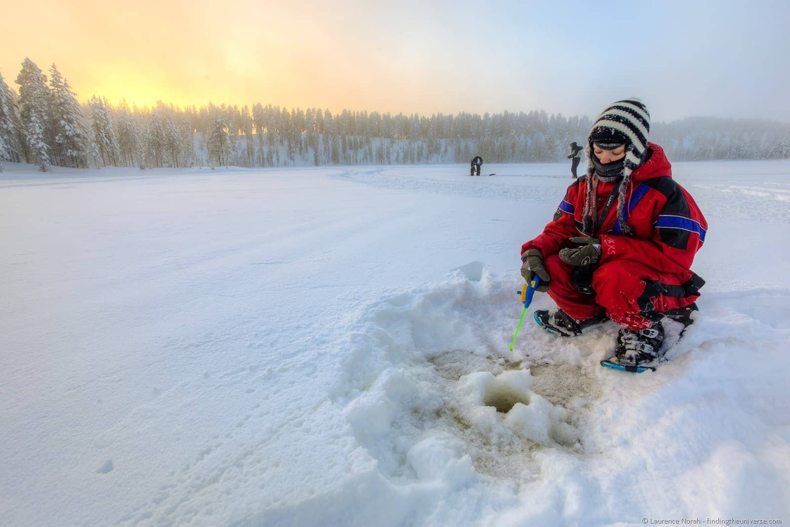 ice fishing girl finland lapland