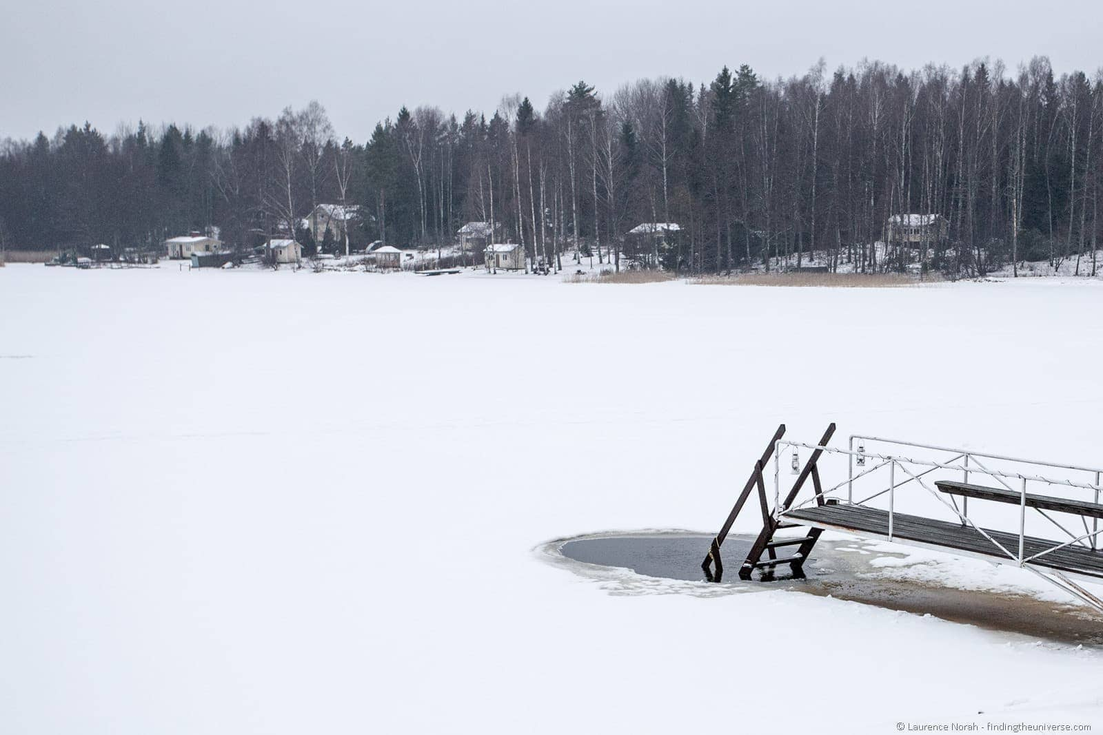 swimming hole in ice sea finland