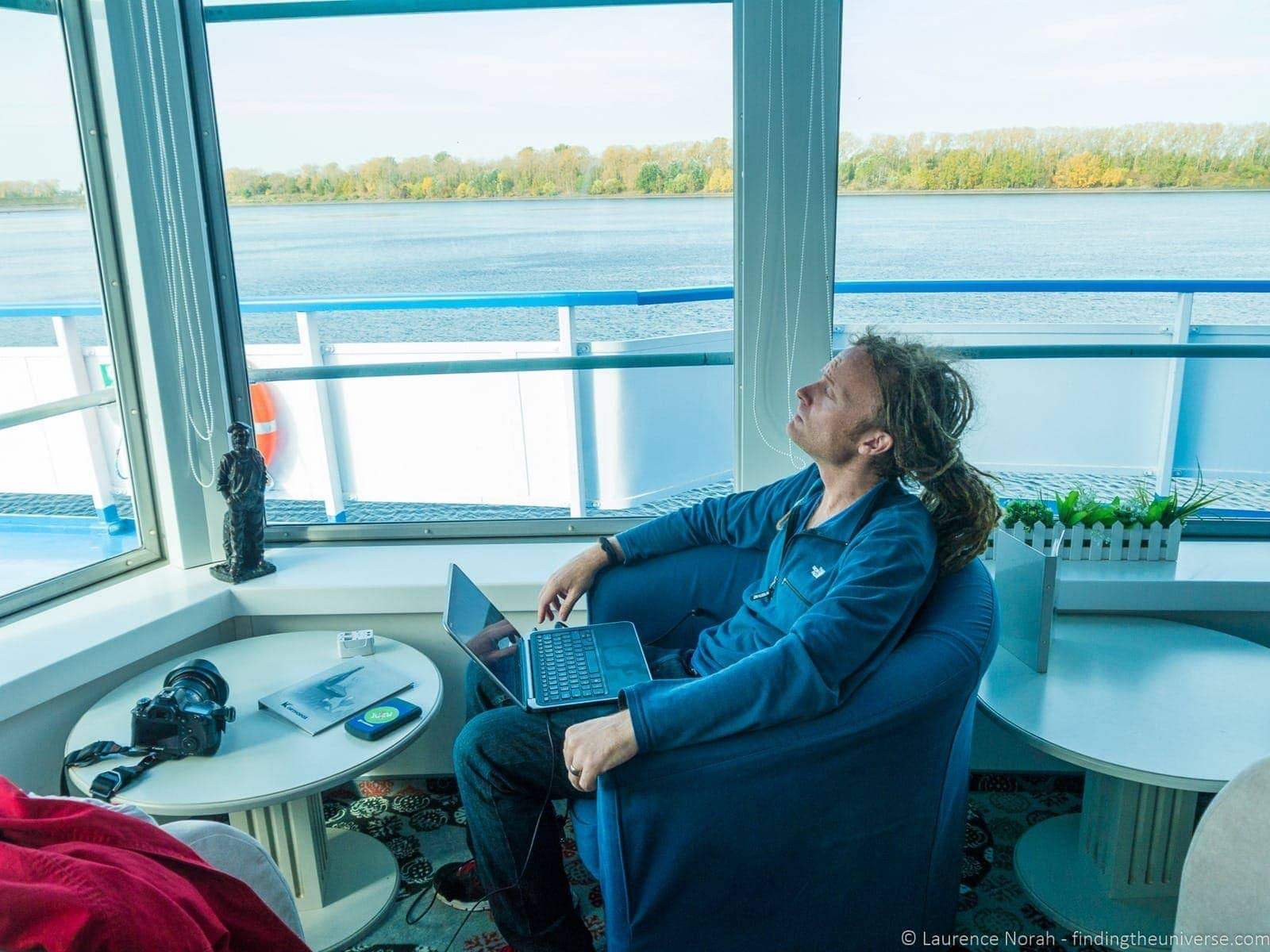 Russia river cruise working on laptop