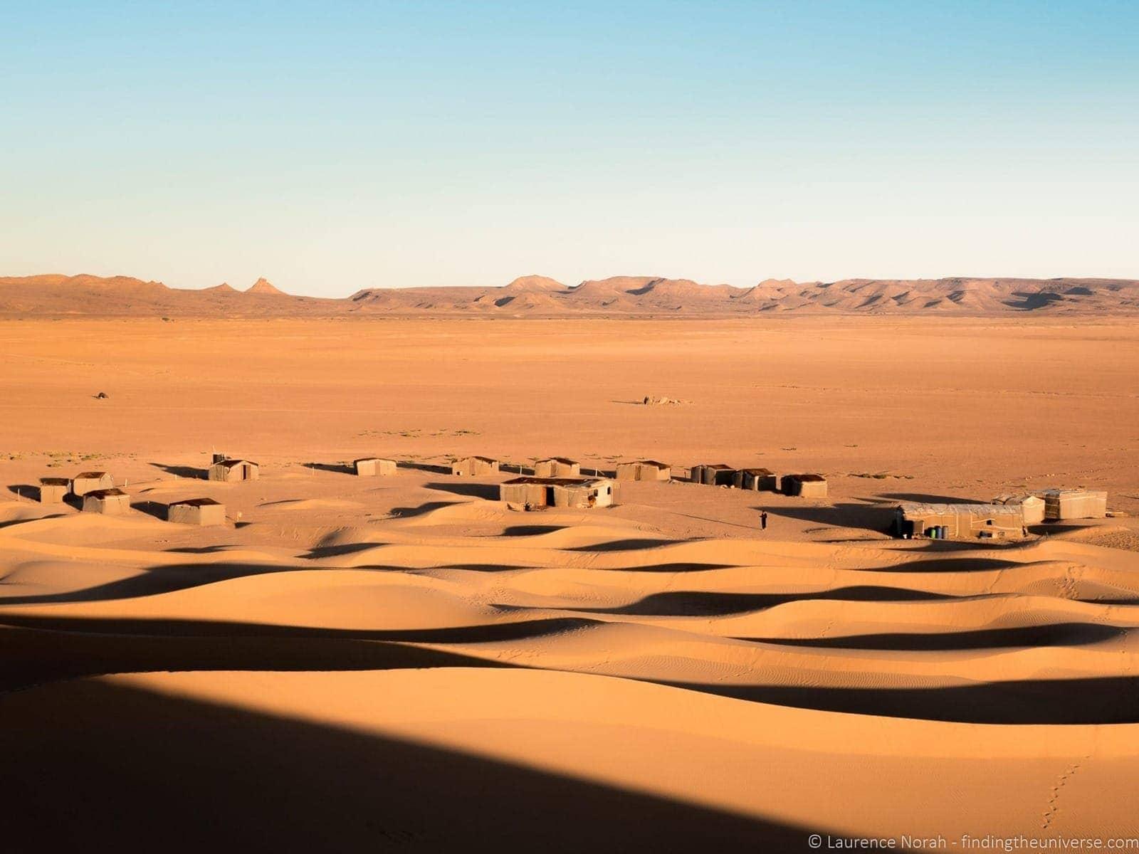 Sand dunes and village Sahara Morocco