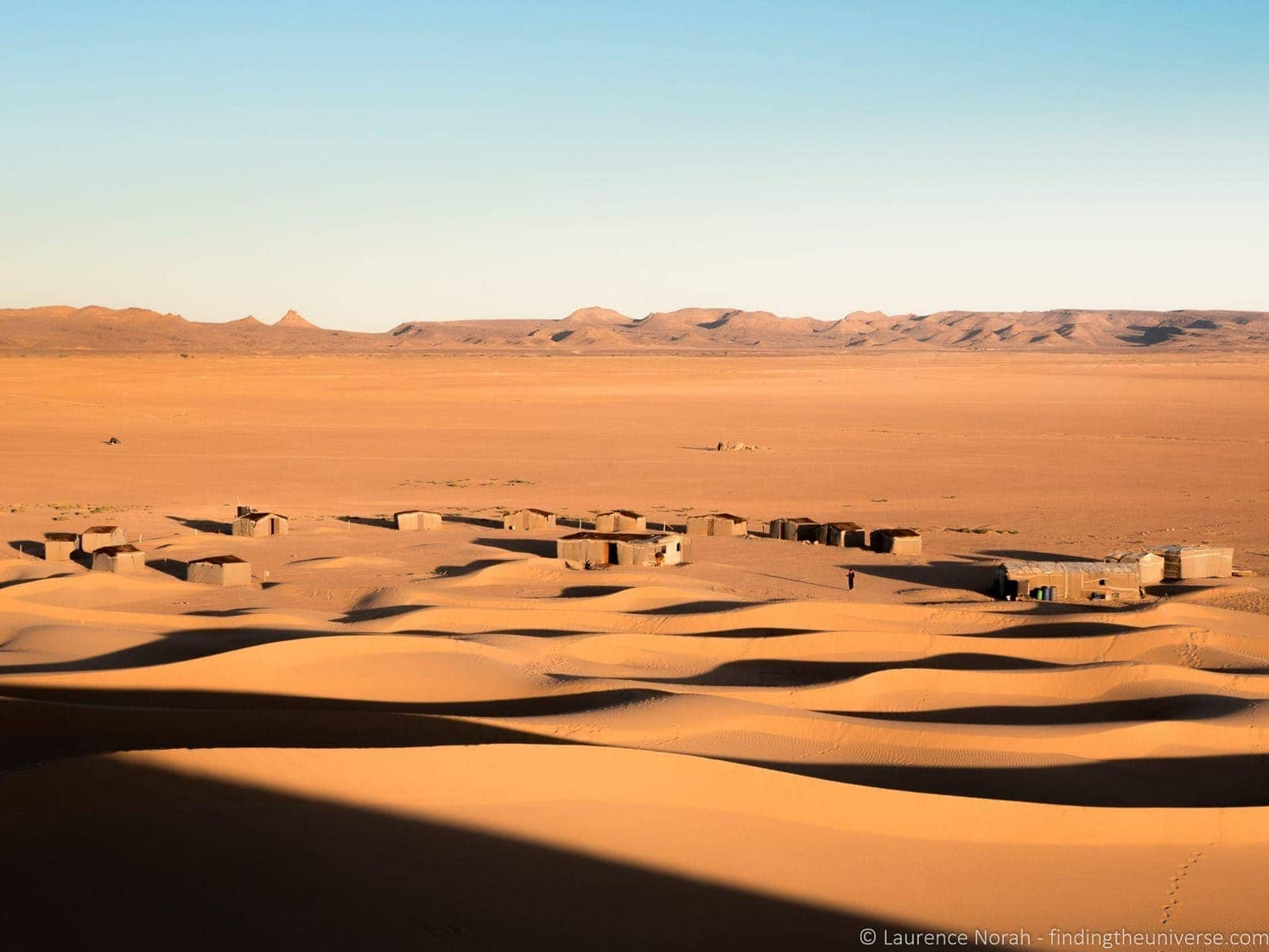 Sand dunes and village Sahara Morocco