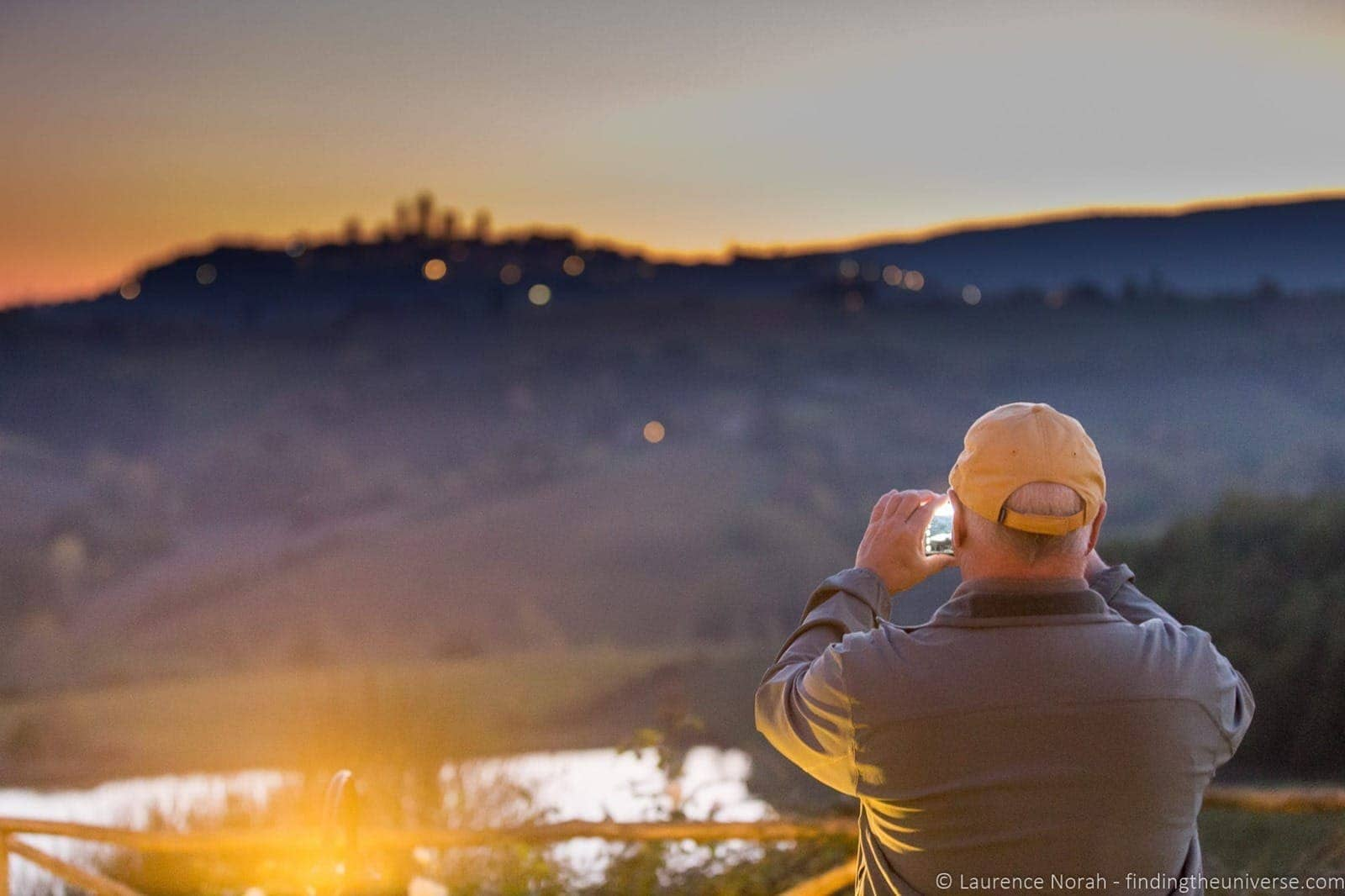 Sunset over San Gimigiano Tuscany man
