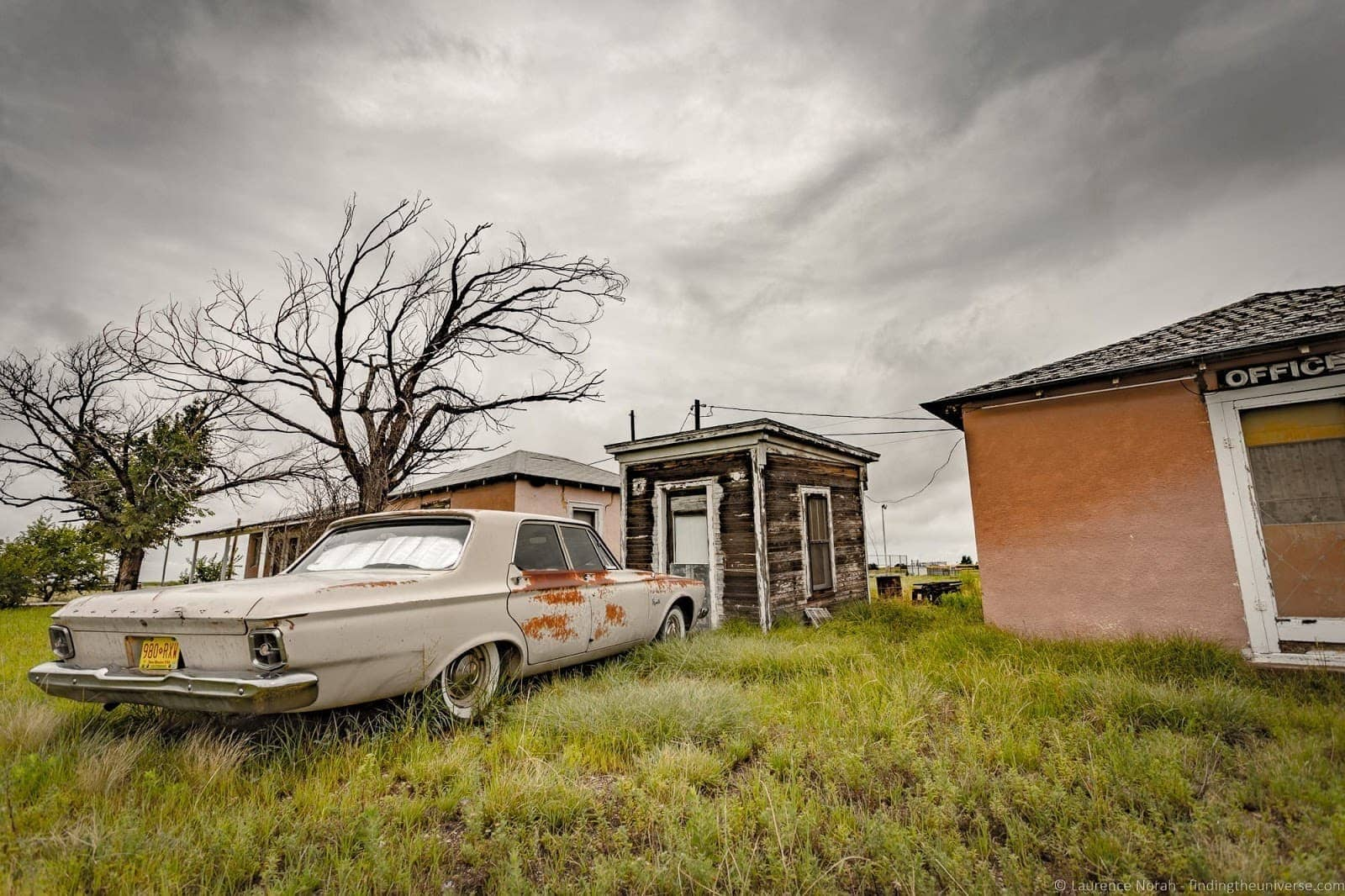 Abandoned car and buildings Route 66 New Mexico