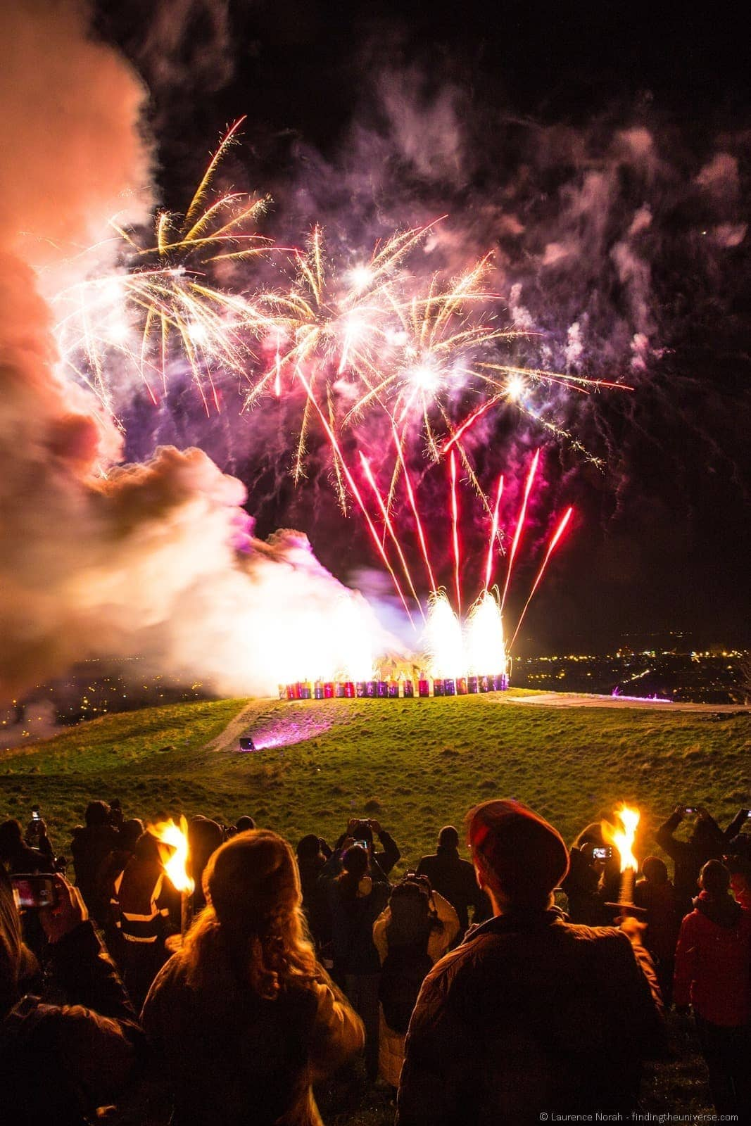 couple watching fireworks hogmanay calton hill edinburgh