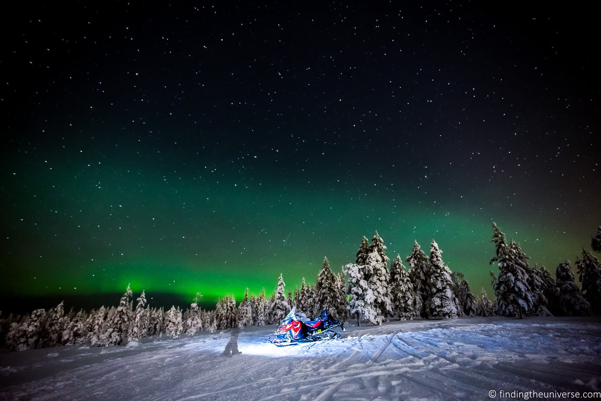 Northern lights Finland snowmobile