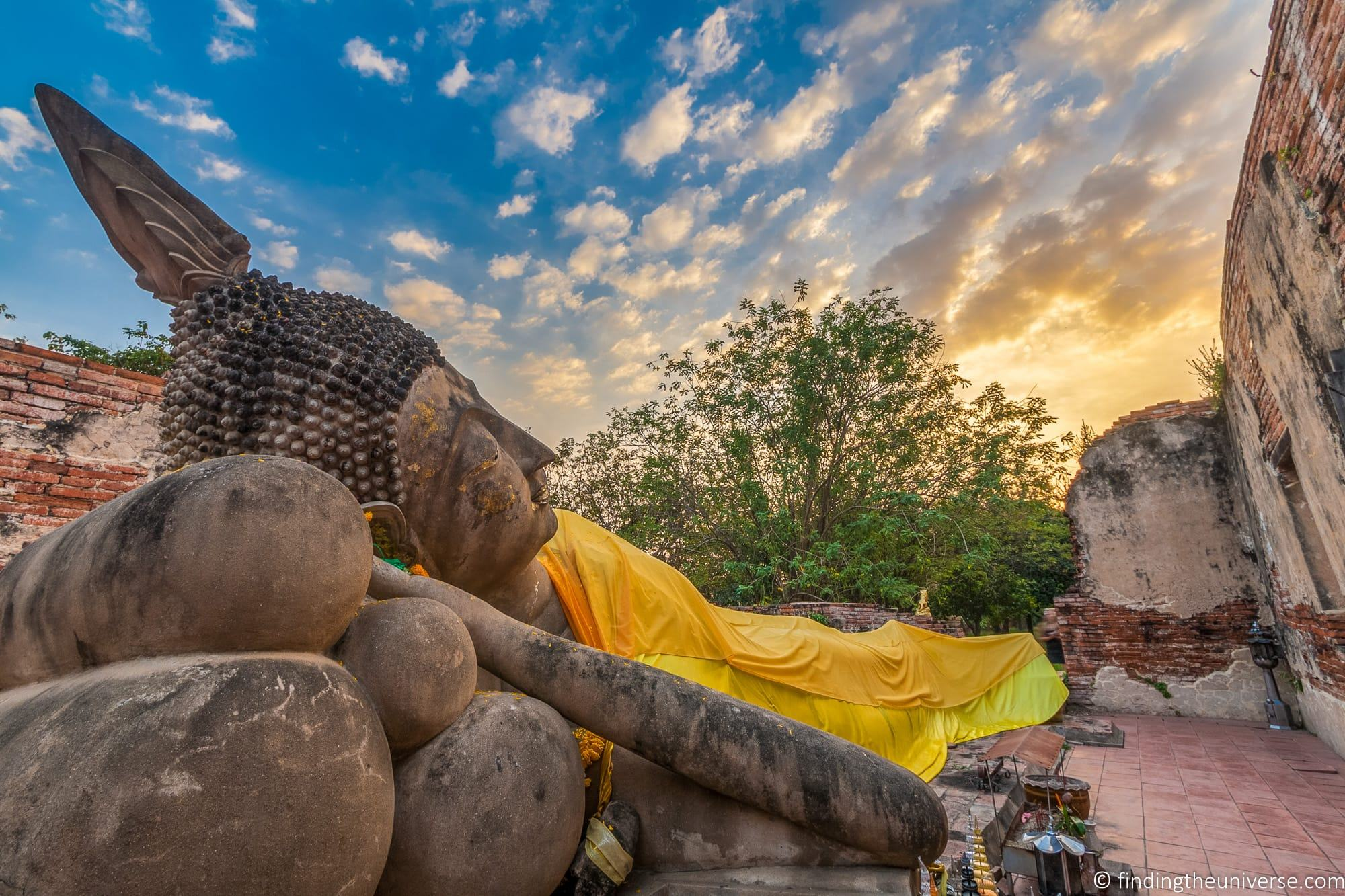 Reclining Buddha at sunset Thailand