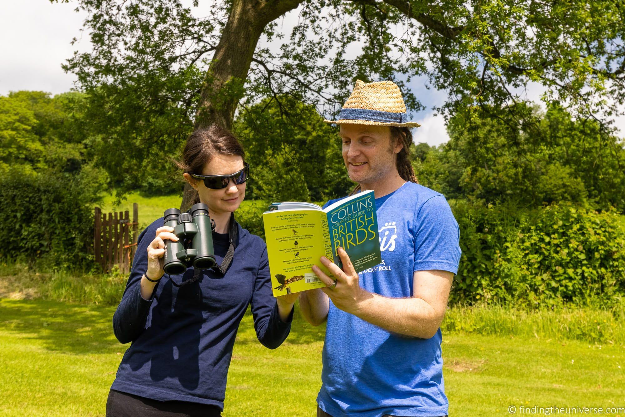 Couple looking at bird book